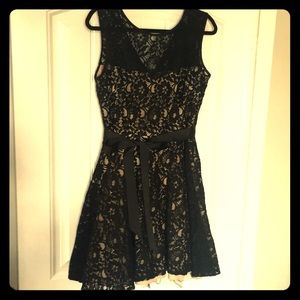 Short black and nude lace dress
